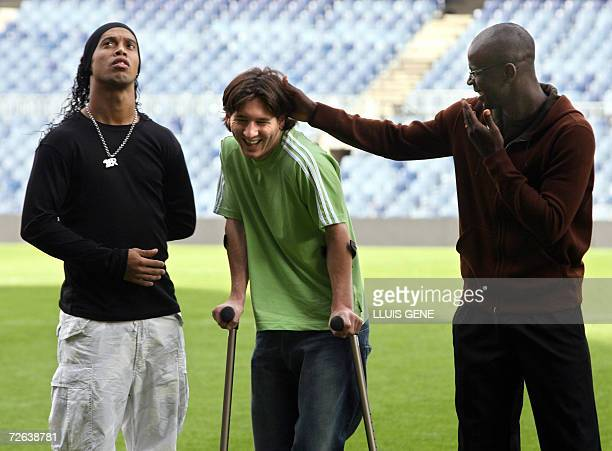 FC Barcelona's football players Argentinian Lionel Messi French Lilian Thuram and Brazilian Ronaldinho joke before receiving the FIFPRO awards at...