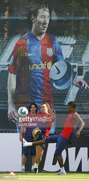 FC Barcelona's Portuguese Deco Cameronian Samuel Eto'o and Argentinian Leo Messi play with a ball during a training session at Camp Nou stadium in...