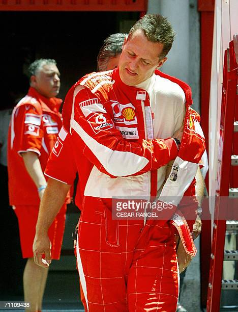 Ferrari Formula 1 driver Michael Schumacher of Germany takes off his racing suit during a training session at the Catalonia racetrack in Montmelo...