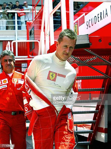 Ferrari Formula 1driver Michael Schumacher of Germany takes off his race suit in the paddock after a training session at the Catalonia racetrack in...