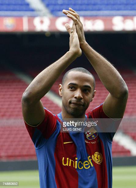 Former Arsenal forward Thierry Henry applauds the fans during his unveiling at Barcelona's Camp Nou stadium, 25 June 2007. Barcelona agreed a...