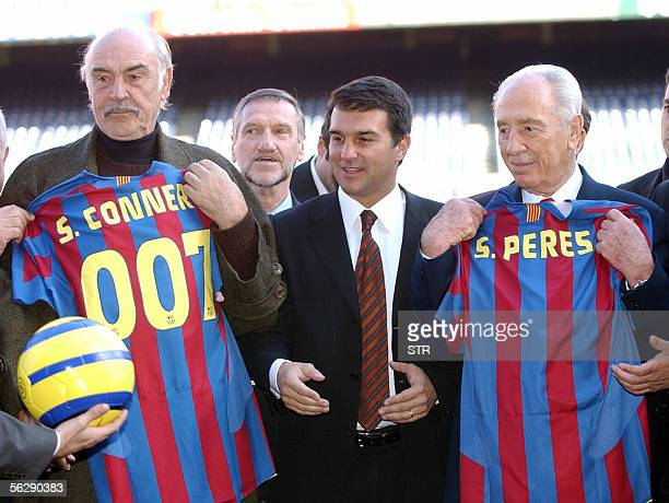 Former Israeli Labour leader Shimon Peres with FC Barcelona's president Joan Laporta and British actor Sean Connery hold their Barcelona's jersey...