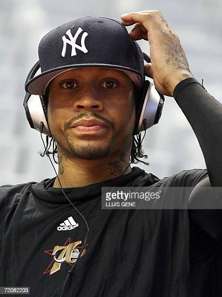 NBA US player Allen Iverson listens to music after a training session in Barcelona's Palau Sant Jordi 4 October 2006 during the NBA Europe Live tour...