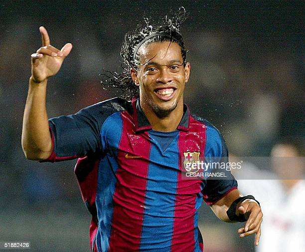 Picture taken 15 October 2003 of Barcelona's Brazilian striker Ronaldinho celebrating after scoring a goal during an UEFA Cup football match in...