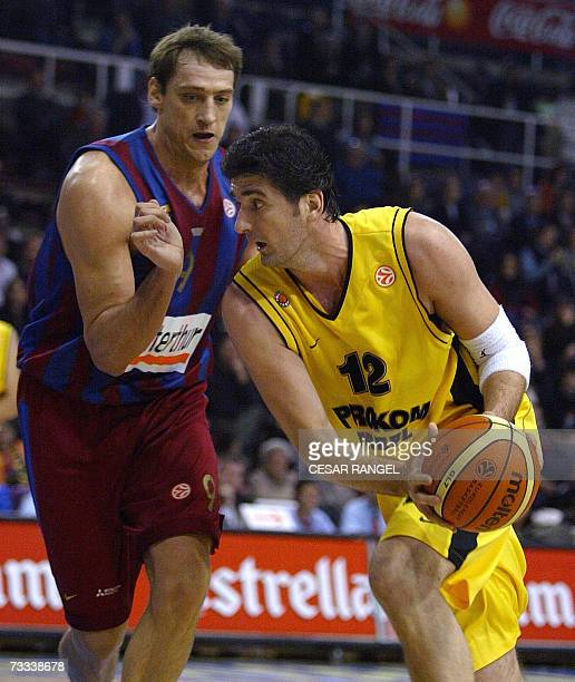 Prokom's HuseyinBesok vies with FC Barcelona's Denis Marconato during their EuroLeague basketball match at Palau Blaugrana in Barcelona 15 February...