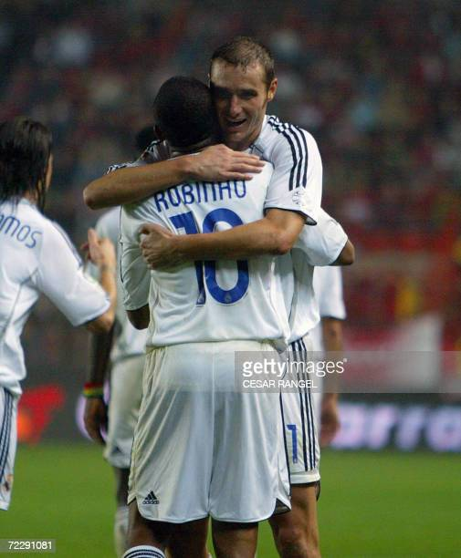Real Madrid's Ivan Helguera congratulates Robinho after he scored against Gimnastic in their Spanish League football match in Tarragona, 28 October...