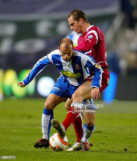 Sevilla's Kepa vies with Espanyol's Miki during their Spanish League football match at the Olympic Stadium in Barcelona 26 February 2006 AFP...