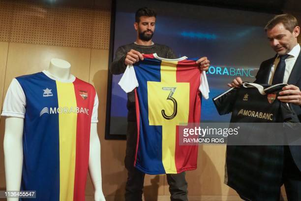 Barcelona Spanish defender and Kosmos investment company president Gerard Pique and general director of MoraBanc financial group Lluis Alsina hold FC...
