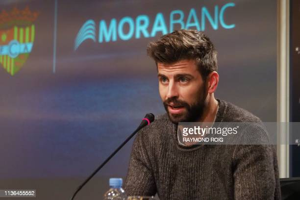 Barcelona Spanish defender and Kosmos investment company president Gerard Pique gives a press conference in Andorra La Vella, on April 12 following...
