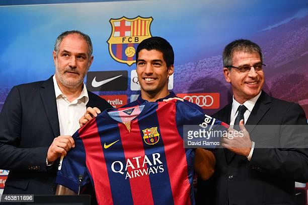 FC Barcelona Sport Director Andoni Zubizarreta Luis Suarez and FC Barcelona Jordi Mestre of FC Barcelona pose for the media during a press conference...