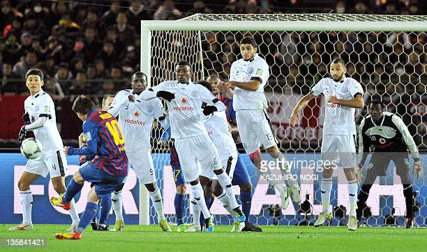 Barcelona sriker Lionel Messi takes a direct free kick against Al Sadd during their semifinal football match of the Club World Cup in Yokohama on...