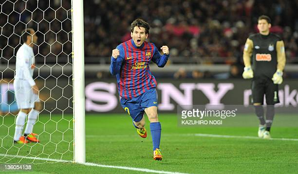 Barcelona striker Lionel Messi celebrates is goal against Santos during the final football match of the FIFA Club World Cup in Yokohama on December...