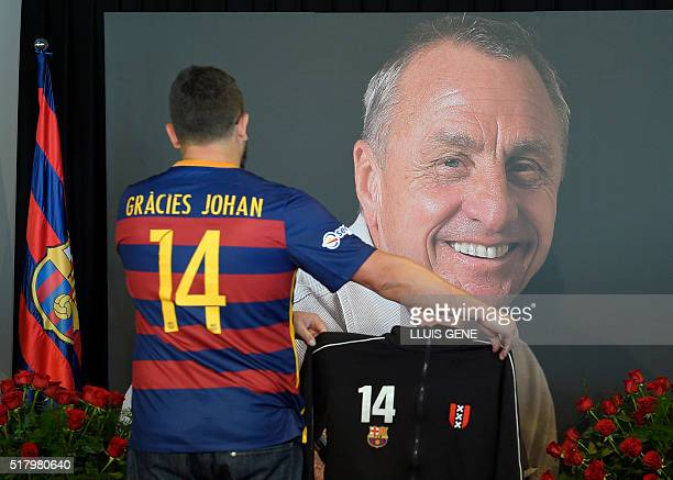 Barcelona supporter pays tribute to late Dutch football star Johan Cruyff in a special condolence area set up at Camp Nou stadium in Barcelona on...