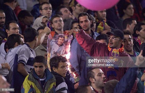 Barcelona supporters burn a portrait of Portugese player Luis Figo 21 October 2000 who left the club for Real Madrid this season during the 1st...
