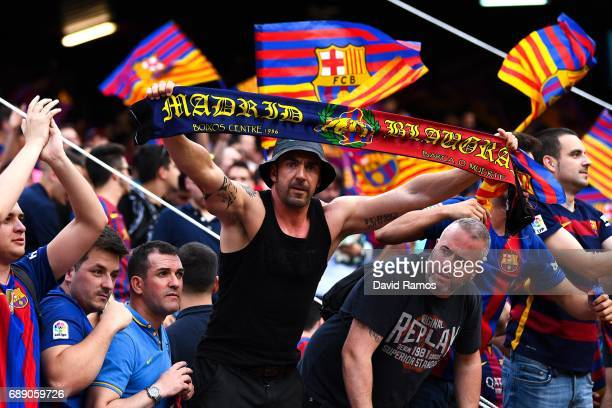 Barcelona supporters cheer on their team prior to the kick off during the Copa Del Rey Final between FC Barcelona and Deportivo Alaves at Vicente...