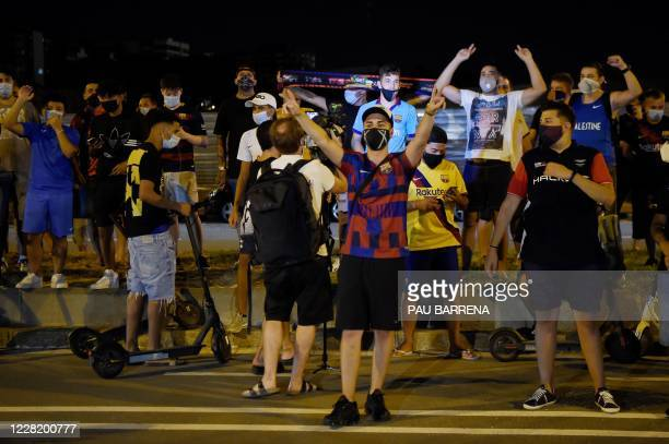 Barcelona supporters gather outside the club's headquarters in Barcelona, on August 25 following the announcement of Argentinian player Lionel...