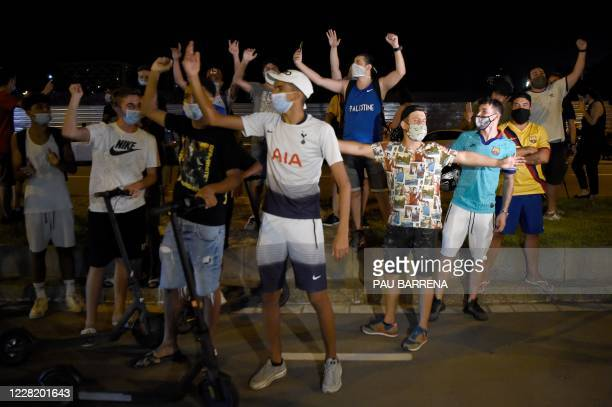 Barcelona supporters shout slogans against the club's board of directors as they gather outside the club's headquarters in Barcelona, on August 25...