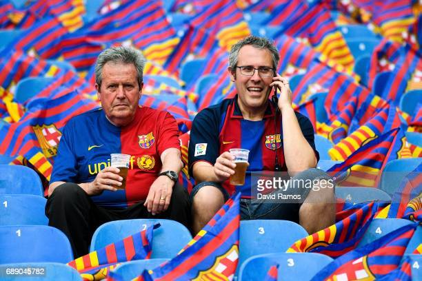 Barcelona supporters sit at the stands prior to the kick off during the Copa Del Rey Final between FC Barcelona and Deportivo Alaves at Vicente...