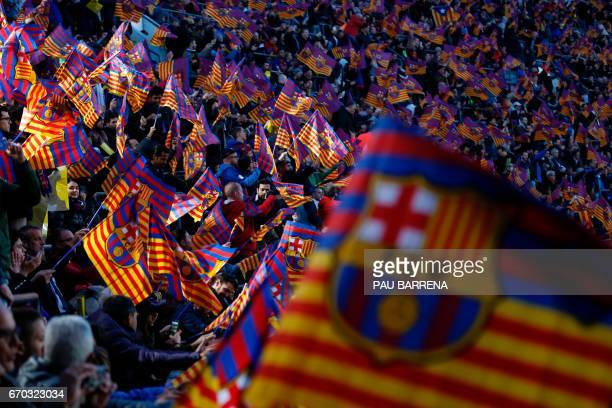 FC Barcelona supporters wave flags before the UEFA Champions League quarterfinal second leg football match FC Barcelona vs Juventus at the Camp Nou...