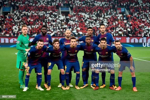 Barcelona team Barcelona's Argentinian forward Lionel Messi Barcelona's Spanish midfielder Sergi Roberto Barcelona's Spanish midfielder Denis Suarez...
