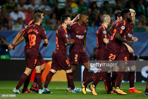 Barcelona team celebrate their goal scored by Sporting's defender Sebastian Coates during the Champions League 2017/18 match between Sporting CP vs...