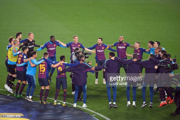 Barcelona team celebrates after winning the match and becoming champions of the Liga at the end of the Spanish League football match between FC...