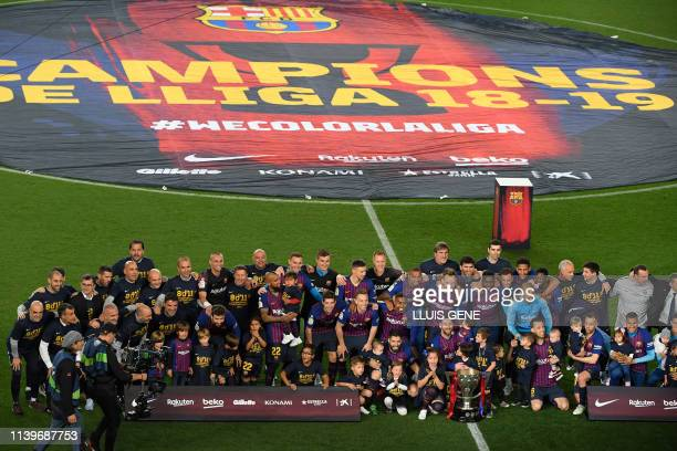 Barcelona team celebrates becoming La Liga champions after winning the Spanish League football match between FC Barcelona and Levante UD at the Camp...