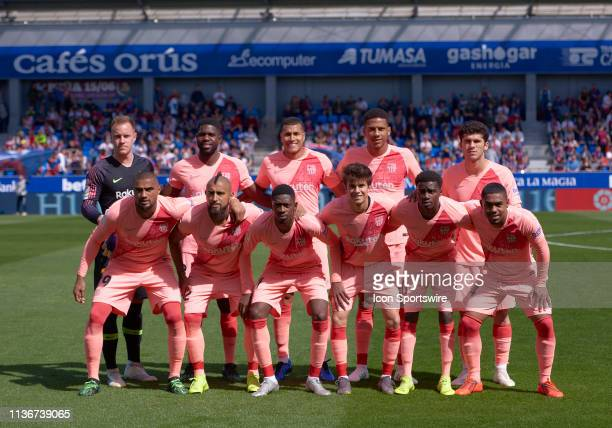 Barcelona team lines up prior looks during the La Liga match between SD Huesca and FC Barcelona at Alcoraz stadium on April 13 2019 in Huesca Spain