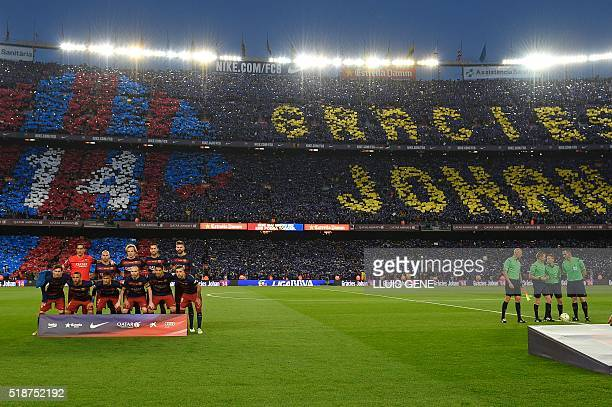 FC Barcelona team pose as supporters holdup coloured rectangular posters to form a giant mosaic reading Thank you Johan in tribute to late Dutch...