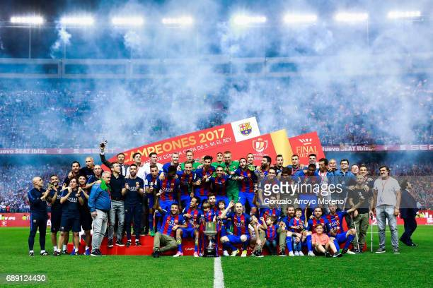 Barcelona team poses for a picture with the King's Cup after winning the Copa Del Rey Final between FC Barcelona and Deportivo Alaves at Vicente...