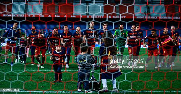 Barcelona team run to their supporter in celebration behind the trophy after the Copa del Rey Final match between FC Barcelona and Sevilla FC at...