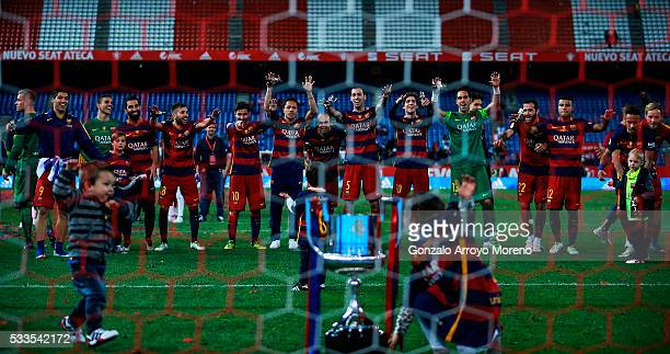 Barcelona team wave to their supporters in celebration behind the trophy after the Copa del Rey Final match between FC Barcelona and Sevilla FC at...