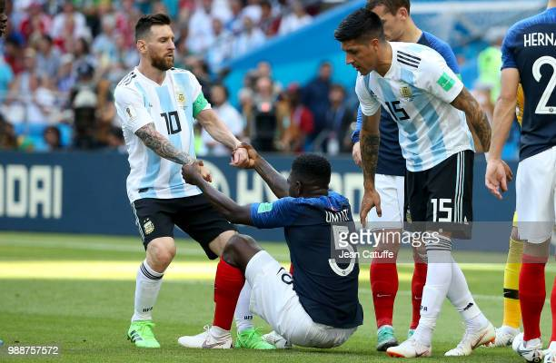 Barcelona teammates Lionel Messi of Argentina and Samuel Umtiti of France during the 2018 FIFA World Cup Russia Round of 16 match between France and...