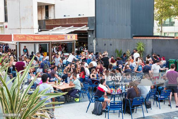 Barcelona, Wapa Tapas Restaurante, busy outdoor bar at happy hour.