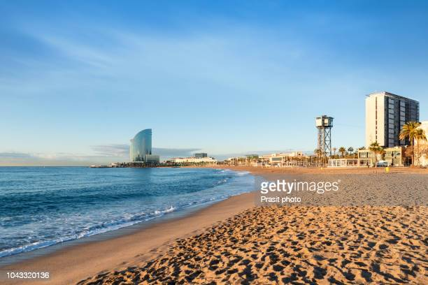 barcelona with blue sky at sunrise. seafront, beach,coast in spain. suburb of barcelona, catalonia - barcelona spanien stock-fotos und bilder