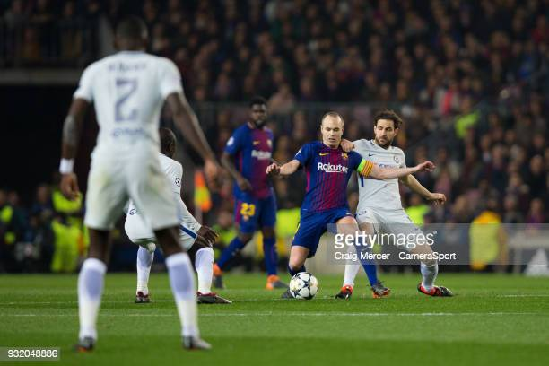 Barcelonas Andre Iniesta holds off the challenge from Chelsea's Cesc Fabregas during the UEFA Champions League Round of 16 Second Leg match FC...