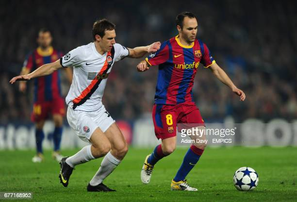 Barcelona's Andres Inesta and Shakhtar Donetsk's Mykola Ishchenko battle for the ball