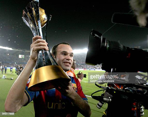 Barcelona's Andres Iniesta celebrates with the trophy after winning the 2009 FIFA Club World Cup at Zayed Sports City Stadium in Abu Dhabi on...