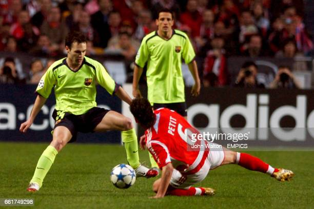 Barcelona's Andres Iniesta is tackled by Benfica's Petit