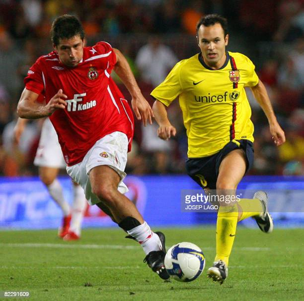 Barcelona's Andres Iniesta vies for the ball with Wisla Cracovias Mauro Cantoro during their UEFA Cup Champions League football match at the New Camp...