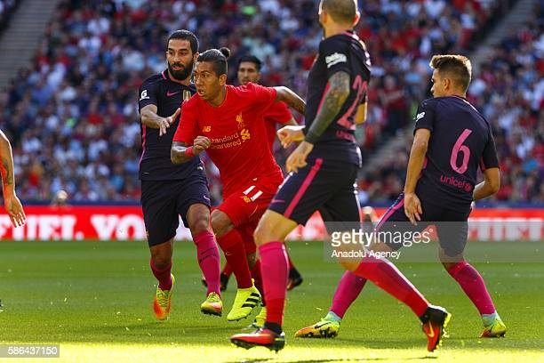 Barcelona's Arda Turan vies with Liverpool's Roberto Firmino during an International Champions Cup match between Liverpool FC and FC Barcelona at...
