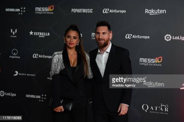 Barcelona's Argentine forward Lionel Messi and his wife Antonella Roccuzzo pose for a photo on the red carpet during the premiere of Cirque du...