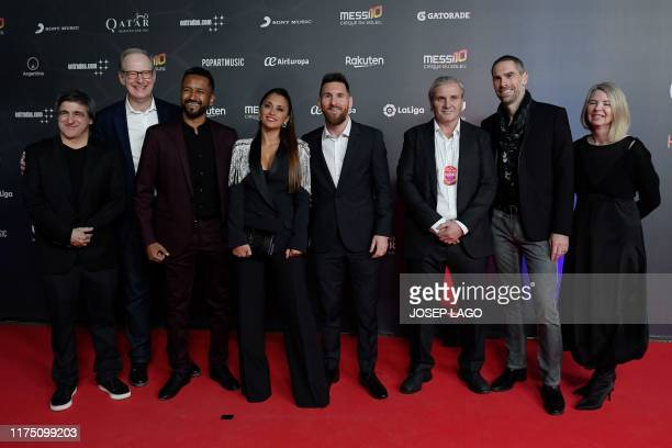 TOPSHOT Barcelona's Argentine forward Lionel Messi and his wife Antonella Roccuzzo pose on the red carpet with Director Mukhtar Omar Sharif Mukhtar...