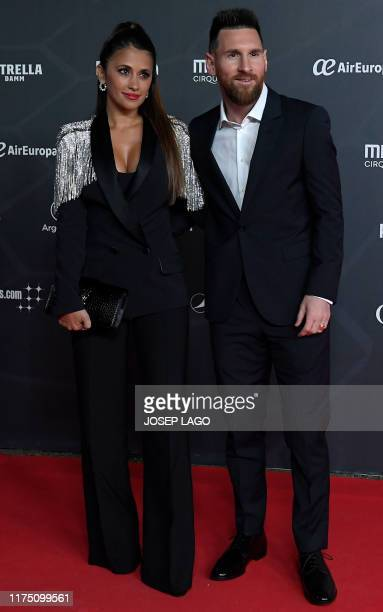 Barcelona's Argentine forward Lionel Messi and his wife Antonella Roccuzzo pose on the red carpet during the premiere of Cirque du Soleil's latest...