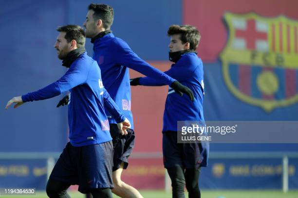 Barcelona's Argentine forward Lionel Messi and teammates attend a training session at the Joan Gamper Sports City training ground in Sant Joan Despi...