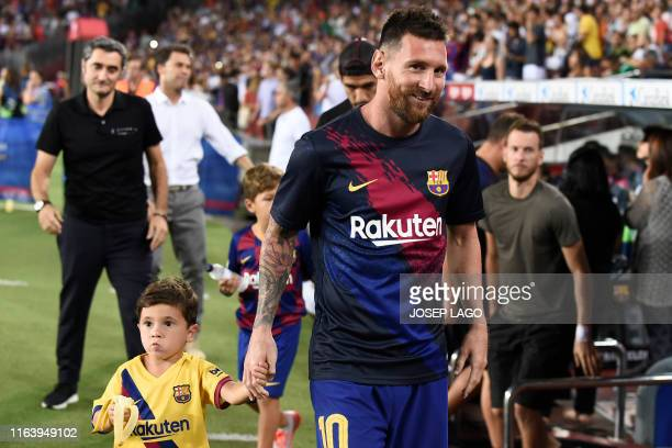 Barcelona's Argentine forward Lionel Messi arrives before the Spanish League football match between Barcelona and Real Betis at the Camp Nou stadium...