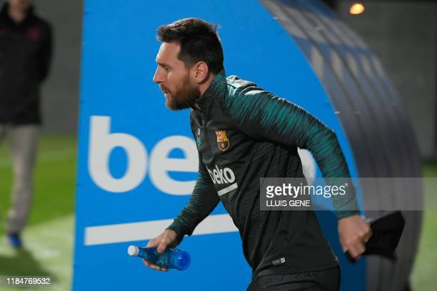 Barcelona's Argentine forward Lionel Messi attends a training session at the Joan Gamper Sports City training ground in Sant Joan Despi, on November...