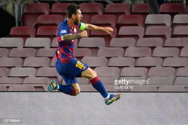 Barcelona's Argentine forward Lionel Messi celebrates after scoring a goal during the UEFA Champions League round of 16 second leg football match...