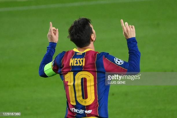 Barcelona's Argentine forward Lionel Messi celebrates after scoring a penalty during the UEFA Champions League football match between FC Barcelona...