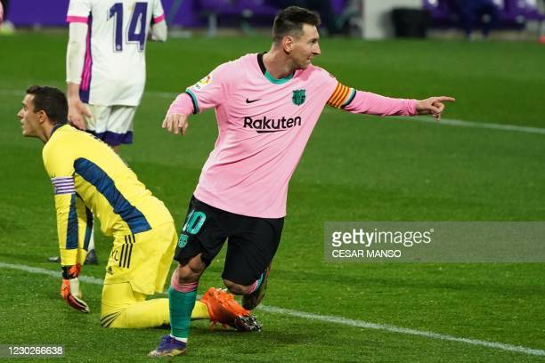 Barcelona's Argentine forward Lionel Messi celebrates after scoring a goal during the Spanish league football match between Real Valladolid FC and FC...